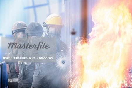 Firefighters in simulation training Stock Photo - Premium Royalty-Free, Image code: 649-06622769