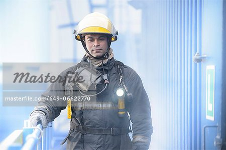 Firefighter standing on platform Stock Photo - Premium Royalty-Free, Image code: 649-06622770
