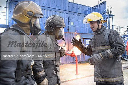 Firefighters in simulation training Stock Photo - Premium Royalty-Free, Image code: 649-06622771