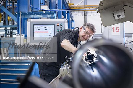 Worker using machinery in factory Stock Photo - Premium Royalty-Free, Image code: 649-06622929