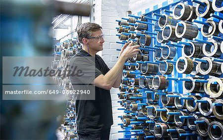 Worker selecting metal coil in factory Stock Photo - Premium Royalty-Free, Image code: 649-06622940