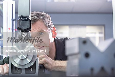 Worker using machinery in factory Stock Photo - Premium Royalty-Free, Image code: 649-06622945