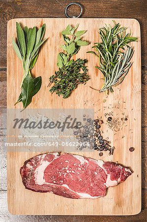 Board laid with meat and seasonings Stock Photo - Premium Royalty-Free, Image code: 649-06622964