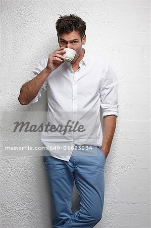 Man drinking cup of coffee Stock Photo - Premium Royalty-Free, Image code: 649-06623034