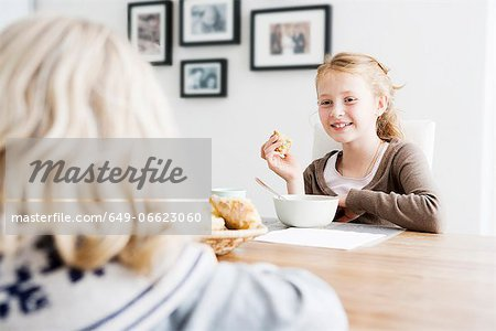 Girls eating lunch at table together Stock Photo - Premium Royalty-Free, Image code: 649-06623060