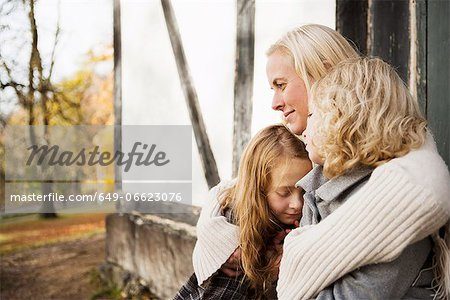 Mother and daughters sitting outdoors Stock Photo - Premium Royalty-Free, Image code: 649-06623076