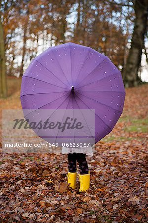 Girl playing with umbrella in park Stock Photo - Premium Royalty-Free, Image code: 649-06623087