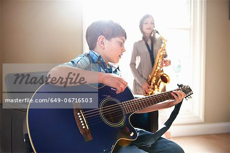 Children playing music together Stock Photo - Premium Royalty-Free, Image code: 649-06716503