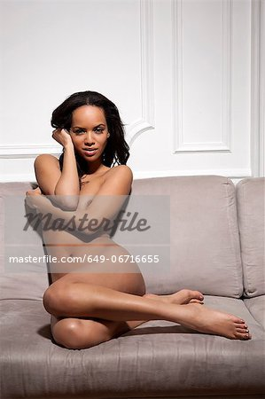 Nude woman sitting on sofa Stock Photo - Premium Royalty-Free, Image code: 649-06716655