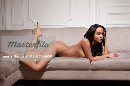 Nude woman laying on sofa