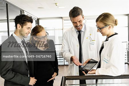 Doctors and business people with tablet Stock Photo - Premium Royalty-Free, Image code: 649-06716740