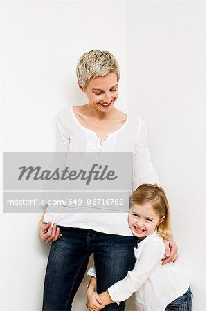 Smiling mother and daughter hugging Stock Photo - Premium Royalty-Free, Image code: 649-06716782