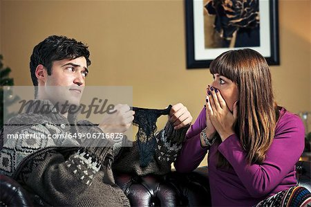 Man giving girlfriend lacy panties Stock Photo - Premium Royalty-Free, Image code: 649-06716875