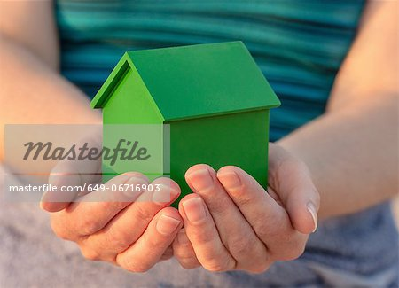 Hands holding model house outdoors Stock Photo - Premium Royalty-Free, Image code: 649-06716903