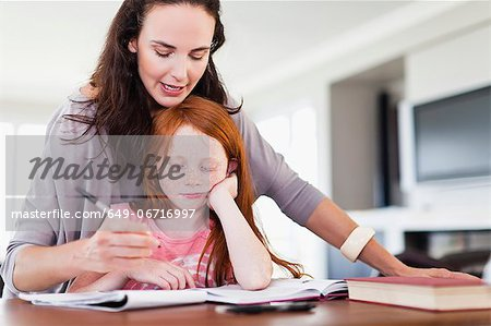 Mother helping daughter with homework Stock Photo - Premium Royalty-Free, Image code: 649-06716997
