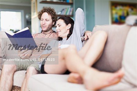 Couple relaxing together on sofa Stock Photo - Premium Royalty-Free, Image code: 649-06717023