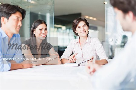 Business people talking in meeting Stock Photo - Premium Royalty-Free, Image code: 649-06717099