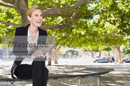 Businesswoman using laptop computer Stock Photo - Premium Royalty-Free, Image code: 649-06717150