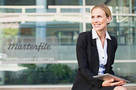 Businesswoman using tablet computer Stock Photo - Premium Royalty-Free, Image code: 649-06717188