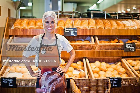 Baker smiling in store Stock Photo - Premium Royalty-Free, Image code: 649-06717206