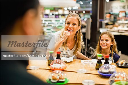 Mother and daughter eating at deli Stock Photo - Premium Royalty-Free, Image code: 649-06717213