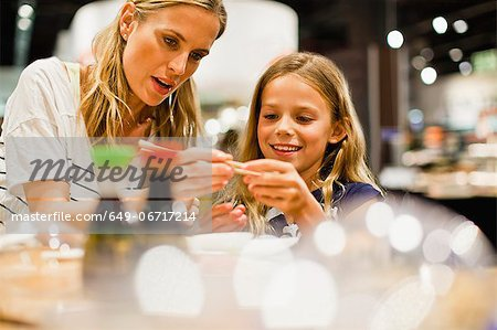 Mother and daughter using chopsticks Stock Photo - Premium Royalty-Free, Image code: 649-06717214
