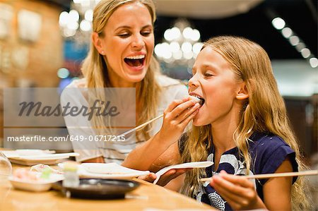 Mother and daughter using chopsticks Stock Photo - Premium Royalty-Free, Image code: 649-06717215