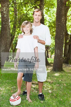 Father and son smiling in park Stock Photo - Premium Royalty-Free, Image code: 649-06717243
