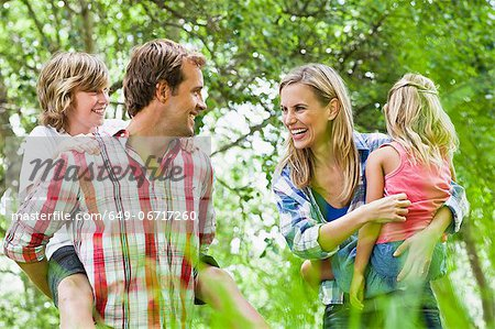 Family walking together in park Stock Photo - Premium Royalty-Free, Image code: 649-06717260