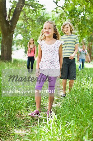 Children walking together in grass Stock Photo - Premium Royalty-Free, Image code: 649-06717263