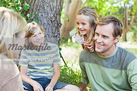 Family relaxing together in park Stock Photo - Premium Royalty-Free, Image code: 649-06717271