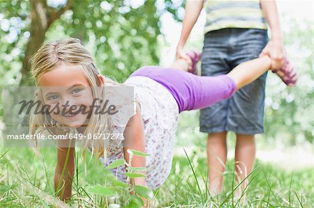 Father and daughter playing in park Stock Photo - Premium Royalty-Free, Image code: 649-06717273