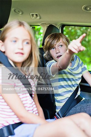 Children sitting in backseat of car Stock Photo - Premium Royalty-Free, Image code: 649-06717284
