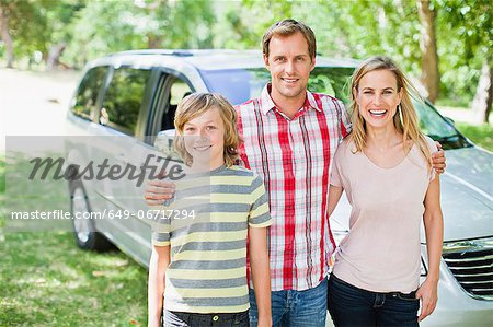 Family smiling together by car Stock Photo - Premium Royalty-Free, Image code: 649-06717294
