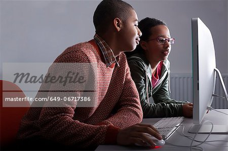 Children using computer together Stock Photo - Premium Royalty-Free, Image code: 649-06717386