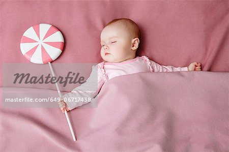Baby girl sleeping in bed Stock Photo - Premium Royalty-Free, Image code: 649-06717438