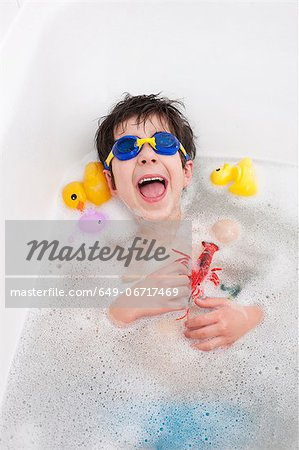 Boy in snorkel mask laughing in bath Stock Photo - Premium Royalty-Free, Image code: 649-06717469