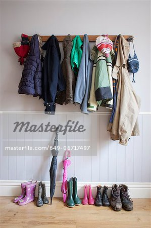 Coats on coat rack with boots Stock Photo - Premium Royalty-Free, Image code: 649-06717497