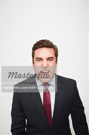Businessman yelling indoors Stock Photo - Premium Royalty-Free, Image code: 649-06717563