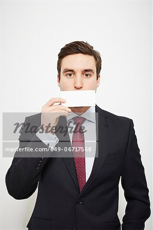 Businessman holding blank card over his face Stock Photo - Premium Royalty-Free, Image code: 649-06717568