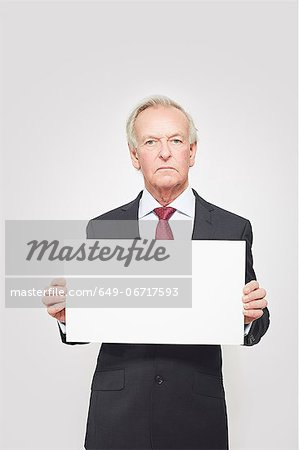 Businessman holding blank card Stock Photo - Premium Royalty-Free, Image code: 649-06717593