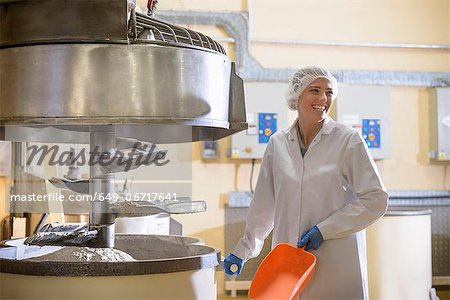 Worker with machinery in biscuit factory Stock Photo - Premium Royalty-Free, Image code: 649-06717641