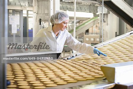 Worker checking production line in factory Stock Photo - Premium Royalty-Free, Image code: 649-06717650