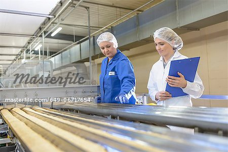 Worker checking production line in factory Stock Photo - Premium Royalty-Free, Image code: 649-06717654