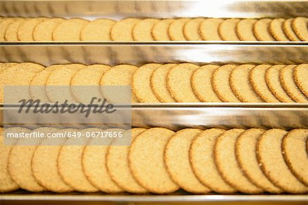 Biscuits on production line in factory Stock Photo - Premium Royalty-Free, Image code: 649-06717656