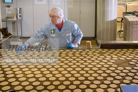 Worker checking production line in factory Stock Photo - Premium Royalty-Free, Image code: 649-06717659