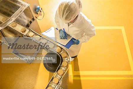 Worker checking production line in factory Stock Photo - Premium Royalty-Free, Image code: 649-06717665