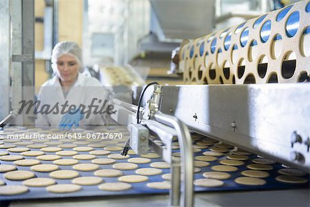 Worker checking production line in factory Stock Photo - Premium Royalty-Free, Image code: 649-06717670