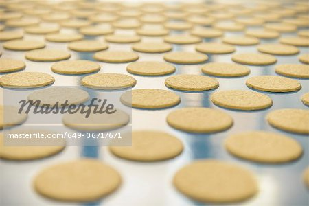 Biscuits on production line in factory Stock Photo - Premium Royalty-Free, Image code: 649-06717671