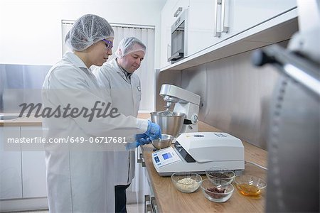 Workers testing in biscuit factory Stock Photo - Premium Royalty-Free, Image code: 649-06717681